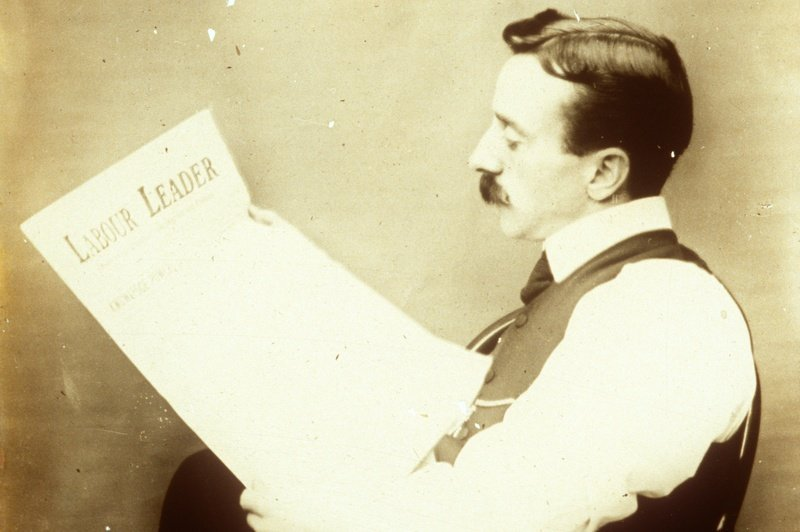 George Absalom Carey reading the Labour Leader